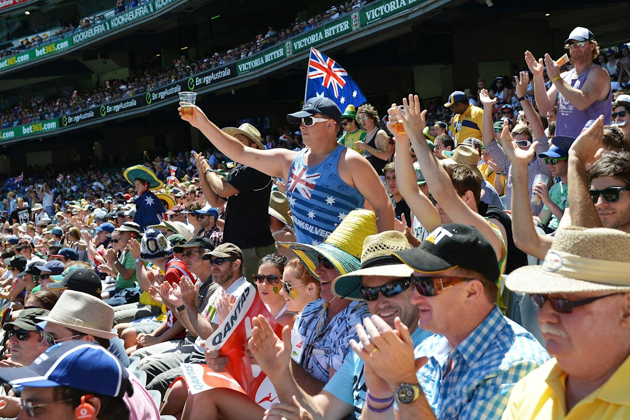 MELBOURNE, AUSTRALIA - DECEMBER 27:  A general view of Australian fans cheering Michael Clarke of Australia after making half century during day two of the Second Test match between Australia and Sri Lanka at Melbourne Cricket Ground on December 27, 2012 in Melbourne, Australia.  (Photo by Vince Caligiuri/Getty Images)