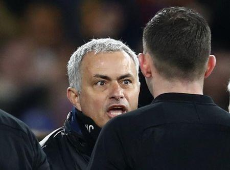 Manchester United manager Jose Mourinho remonstrates with referee Michael Oliver after the match