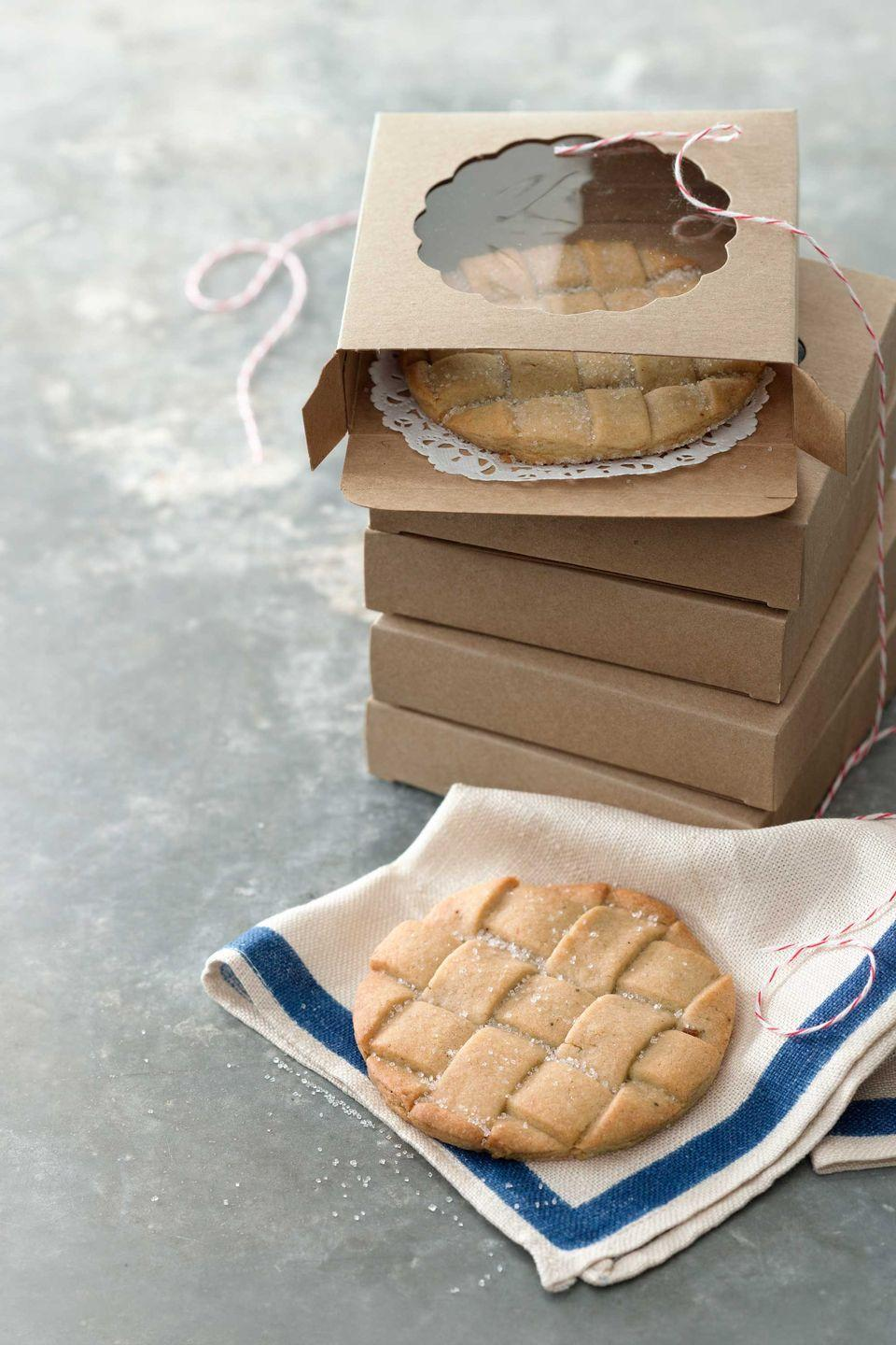 """<p>If you love sugar cookies and buttery pie crust, these cookies are for you. They are simple, elegant, and sure to impress. Try gifting them at a Christmas cookie swap or bring them to your next holiday party.</p><p><strong><a href=""""https://www.countryliving.com/food-drinks/recipes/a4406/cinnamon-sugar-lattice-cookies-recipe-clx1213/"""" rel=""""nofollow noopener"""" target=""""_blank"""" data-ylk=""""slk:Get the recipe"""" class=""""link rapid-noclick-resp"""">Get the recipe</a>.</strong></p><p><a class=""""link rapid-noclick-resp"""" href=""""https://www.amazon.com/CK-Products-Sanding-Sugar-White/dp/B0001W6NTO?tag=syn-yahoo-20&ascsubtag=%5Bartid%7C10050.g.647%5Bsrc%7Cyahoo-us"""" rel=""""nofollow noopener"""" target=""""_blank"""" data-ylk=""""slk:SHOP SANDING SUGARS"""">SHOP SANDING SUGARS</a><br></p>"""