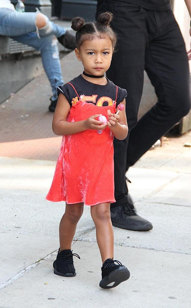 <p>North's clashing enemble makes her look like a rockstar. She must have gotten ready with Kendall that morning. (Photo: Backgrid) </p>