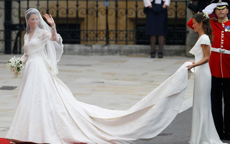 This Friday, April 29, 2011 photo shows Kate Middleton accompanied by maid of honour Pippa Middleton, right, as she arrives at Westminster Abbey at the Royal Wedding in London. - Credit: Alastair Grant/AP