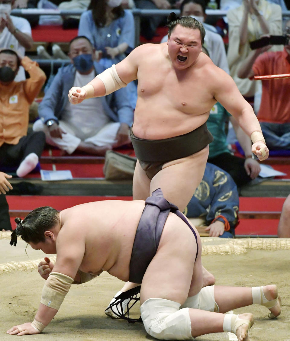 Mongolian-born sumo grand champion Hakuho reacts after defeating then champion Terunofuji at the Nagoya Grand Sumo Tournament to win his 45th victory in the tournaments, in Nagoya, central Japan, on July 18, 2021. Hakuho is retiring at age 36, marking an end of an era in the history of Japanese traditional sport. The Mongolian-born Yokozuna, or grand champion, Hakuho has won a record 45 tournaments, including 16 perfect victories, which is also a record. (Kyodo News via AP)