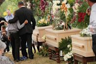Relatives embrace during the funeral service of Dawna Ray Langford and her sons Trevor, Rogan, who were killed by unknown assailants, to be buried at the cemetery in La Mora