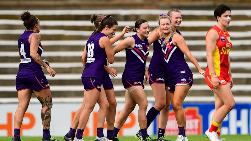 Fremantle Dockers players, pictured here celebrating a goal in their AFLW semi-final against Gold Coast.