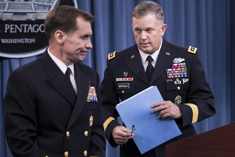 Rear Admiral John Kirby (L) and Lt. Genearl William C. Mayville Jr. leave after a briefing at the Pentagon on September 23, 2014 in Washington, DC (AFP Photo/Brendan Smialowski)