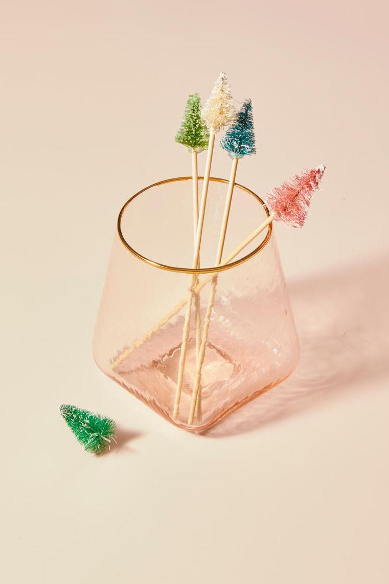 """<p>Bring more holiday cheer to your guests' drinks with some fun skewers fit for the occasion. Cut your drink skewers to about 3"""" long, then attach mini bottle brush trees in fun colors to the top of each one. Simple hot glue works well for this project. <br></p><p><a class=""""link rapid-noclick-resp"""" href=""""https://www.amazon.com/Haiabei-Christmas-Crafting-Displaying-Decoration/dp/B07JLZ1SPV/?tag=syn-yahoo-20&ascsubtag=%5Bartid%7C10055.g.2196%5Bsrc%7Cyahoo-us"""" rel=""""nofollow noopener"""" target=""""_blank"""" data-ylk=""""slk:SHOP BOTTLE BRUSH TREES"""">SHOP BOTTLE BRUSH TREES </a> </p>"""