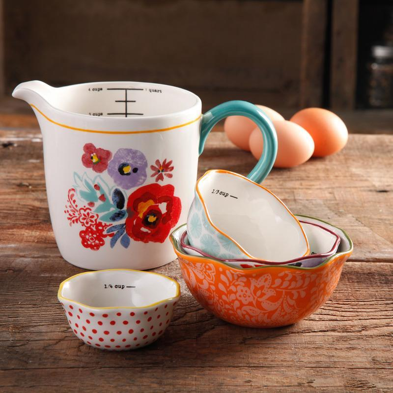 """<p>The set's durable stoneware composition, along with its assorted hand-painted designs, make it an excellent choice for any home cook. Available at Walmart, <a href=""""http://www.walmart.com/ip/Pioneer-Woman-Flea-Market-5-Piece-Prep-Set-4-Piece-Measuring-Cups-with-4-Piece-Measuring-Bowls-Decorated/46040017"""" rel=""""nofollow noopener"""" target=""""_blank"""" data-ylk=""""slk:$14.86"""" class=""""link rapid-noclick-resp"""">$14.86</a>.<br></p>"""
