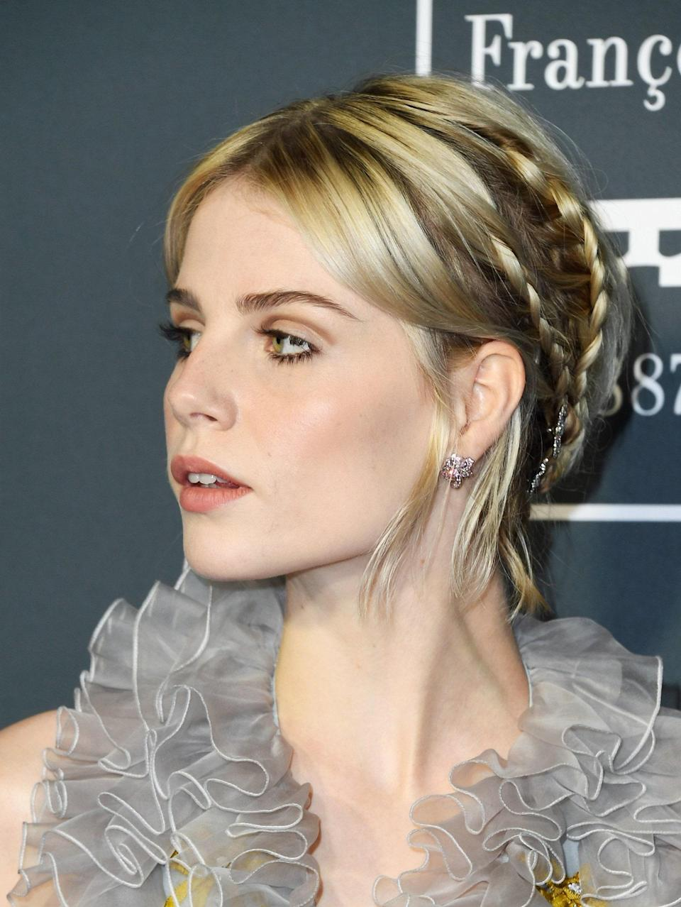 """Lucy Boynton's creamy blond color is basically a lesson in tones. """"It works with all skin tones because of the subtle warm and cool reflects,"""" says <a href=""""https://www.instagram.com/minkimcolorist/?hl=en"""" rel=""""nofollow noopener"""" target=""""_blank"""" data-ylk=""""slk:Min Kim"""" class=""""link rapid-noclick-resp"""">Min Kim</a>, senior colorist at <a href=""""https://www.butterflystudiosalon.com/"""" rel=""""nofollow noopener"""" target=""""_blank"""" data-ylk=""""slk:Butterfly Studio Salon"""" class=""""link rapid-noclick-resp"""">Butterfly Studio Salon</a>. """"If you're on the darker shade of blond, ask for a beige version—which is deeper and just as complementary for all skin tones."""""""