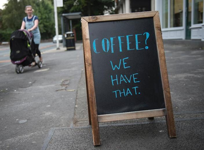 Numerous bars and coffee shops in England have also started sharing quotes and witticisms (AFP Photo/Oli Scarff)