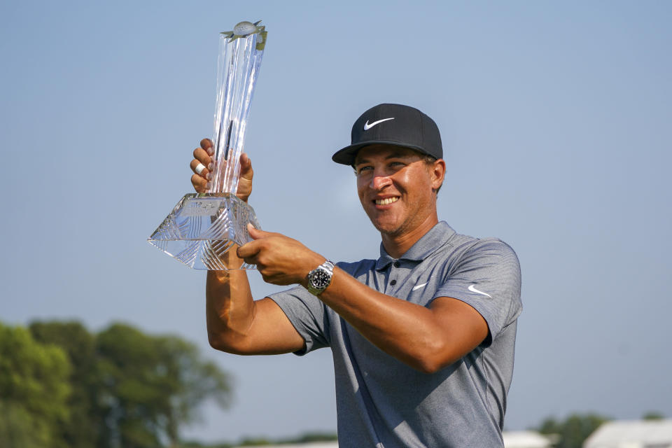 Cameron Champ holds up the 3M Open trophy after winning the 3M Open golf tournament in Blaine, Minn., Sunday, July 25, 2021. (AP Photo/Craig Lassig)