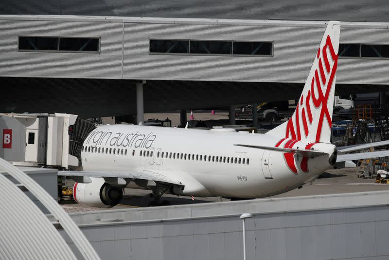 FILE PHOTO: A Virgin Australia plane at Kingsford Smith International Airport after Australia implemented an entry ban on non-citizens and non-residents due to the coronavirus outbreak