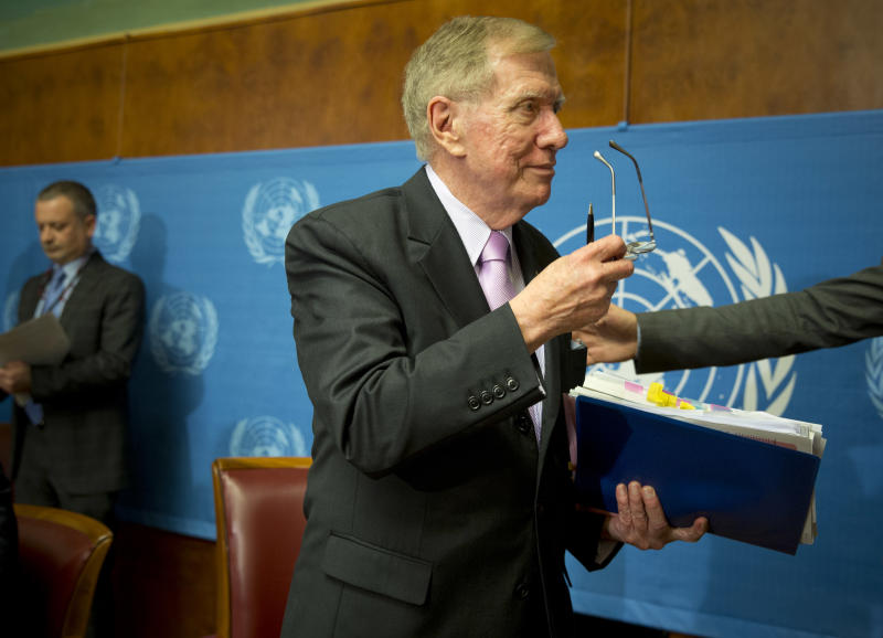 """Retired Australian judge Michael Kirby, center, chairperson of the commission of Inquiry on Human Rights in the Democratic People's Republic of Korea, takes off his glasses after delivering the commission's report during a press conference at the United Nations in Geneva, Switzerland, Monday, Feb. 17, 2014. A U.N. panel has warned North Korean leader Kim Jong Un that he may be held accountable for orchestrating widespread crimes against civilians in the secretive Asian nation. Kirby told the leader in a letter accompanying a yearlong investigative report on North Korea that international prosecution is needed """"to render accountable all those, including possibly yourself, who may be responsible for crimes against humanity."""" (AP Photo/Anja Niedringhaus)"""