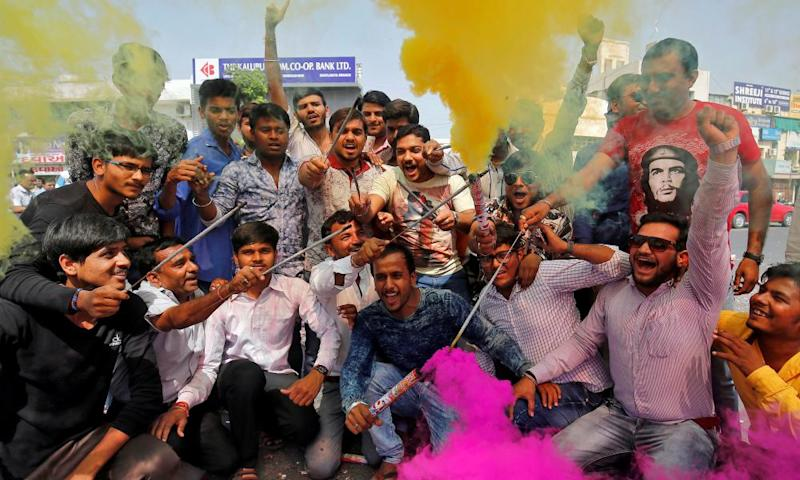 BJP supporters celebrate in Ahmedabad after Yogi Adityanath was sworn in as chief minister of Uttar Pradesh.