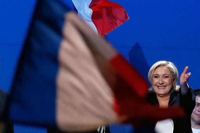 <p>French far-right presidential candidate Marine Le Pen waves to supporters during her meeting, Monday May 1, 2017, in Villepinte, outside Paris. With just six days until a French presidential vote that could define Europe's future, far-right leader Marine Le Pen and centrist Emmanuel Macron are holding high-stakes rallies Monday. (AP Photo/Francois Mori) </p>