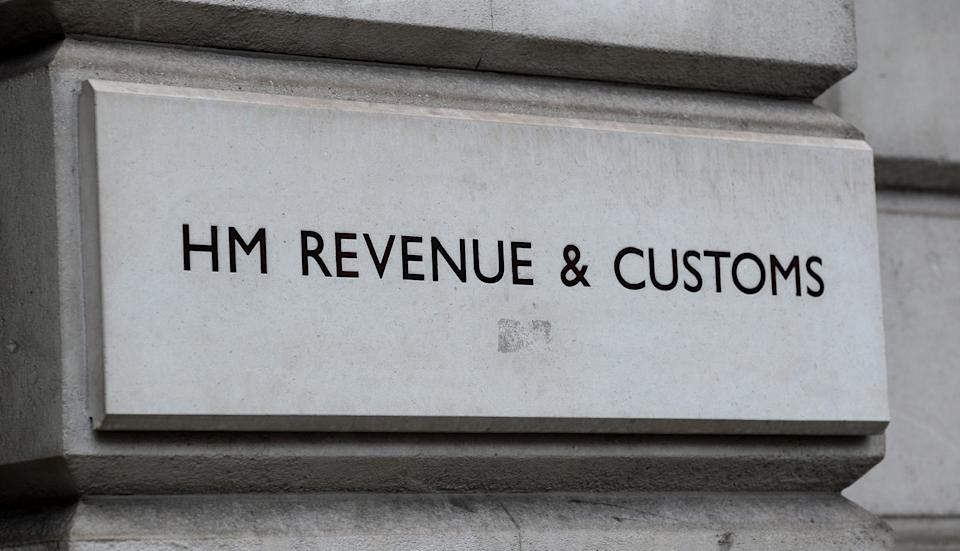 A sign for HM Revenue & Customs (HMRC) in Westminster, London