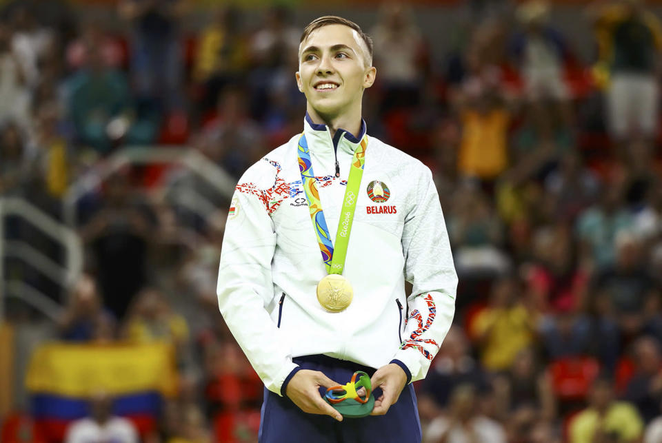 <p>Uladzislau Hancharou of Belarus with his gold medal on the podium after winning the men's trampoline final at the Rio Olympic Arena on August 13, 2016. (REUTERS/Mike Blake) </p>