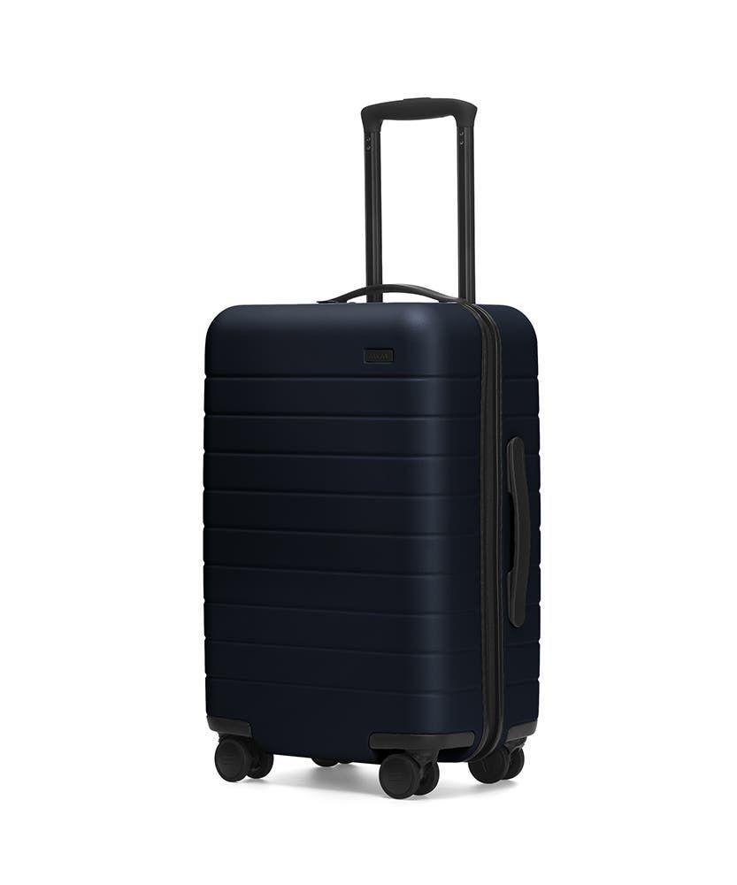 """<p>awaytravel.com</p><p><strong>$225.00</strong></p><p><a href=""""https://go.redirectingat.com?id=74968X1596630&url=https%3A%2F%2Fwww.awaytravel.com%2Fsuitcases%2Fcarry-on%2Fnavy&sref=https%3A%2F%2Fwww.thepioneerwoman.com%2Fhome-lifestyle%2Fg36124040%2Fgraduation-gifts-for-boys%2F"""" rel=""""nofollow noopener"""" target=""""_blank"""" data-ylk=""""slk:Shop Now"""" class=""""link rapid-noclick-resp"""">Shop Now</a></p><p>An array of fabulous colors and a just-roomy-enough fit makes this carry-on a great choice for any traveler. There's even a removable battery for all their charging needs.</p>"""
