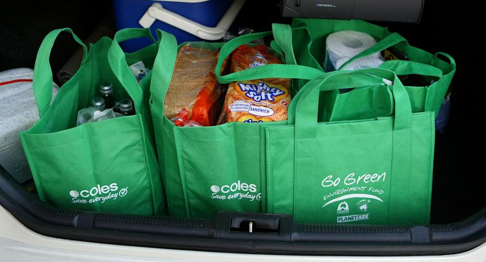 Placing groceries too far back in the car boot can strain the body when lifting them out later, so keep them close. Source: Getty