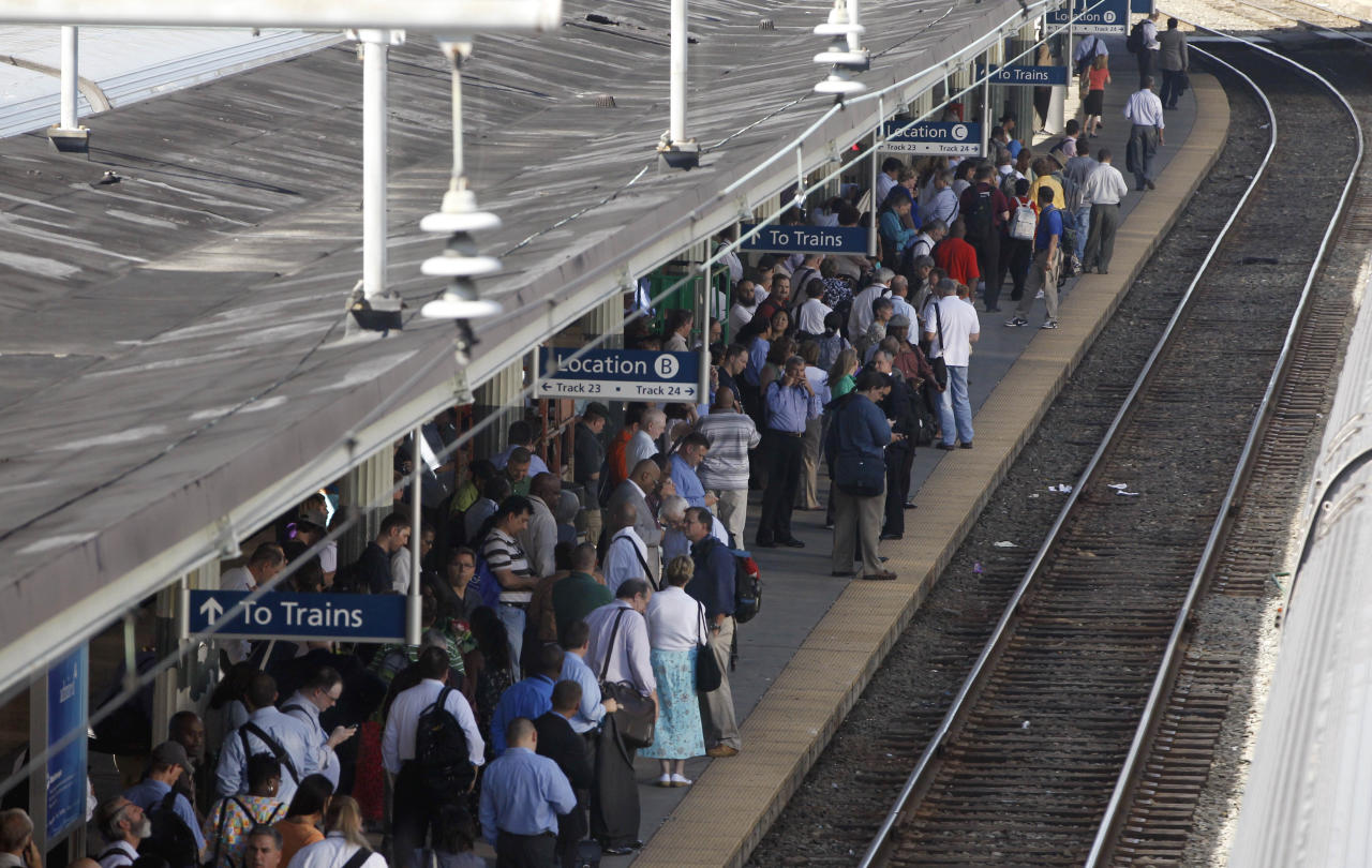 Passengers crowd the platform of a commuter train as they wait for it to arrive at Union Station in Washington, Tuesday, Aug. 23, 2011, after an earthquake in the Washington area. A 5.9 magnitude earthquake centered in Virginia forced evacuations of all the monuments on the National Mall in Washington and rattled nerves from Georgia to Martha's Vineyard, the Massachusetts island where President Barack Obama is vacationing. No injuries were immediately reported. (AP Photo/Charles Dharapak)