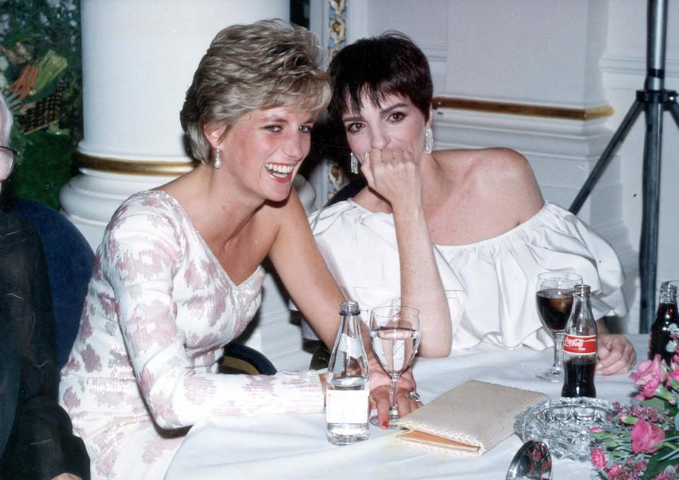"""LONDON - SEPTEMBER 20: Lady Diana, Princess of Wales (1961 - 1997) laughs with American performer Liza Minnelli at a party following the charity film premiere of """"Stepping Out"""", at the Langham Hilton Hotel on September 20, 1991 in London. (Photo by Dave Benett/Getty Images)"""