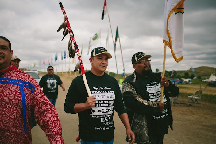 <p>Fort Mojave Tribal Counsel members Johnny Hemmers, at right, and Timothy Williams return to camp after standing at the Dakota Access Pipeline protest site on Tuesday, Sept. 6, 2016. (Photo: Alyssa Schukar for Yahoo News) </p>