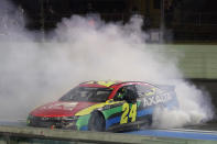 William Byron does doughnuts as he celebrates after winning a NASCAR Cup Series auto race, Sunday, Feb. 28, 2021, in Homestead, Fla. (AP Photo/Wilfredo Lee)