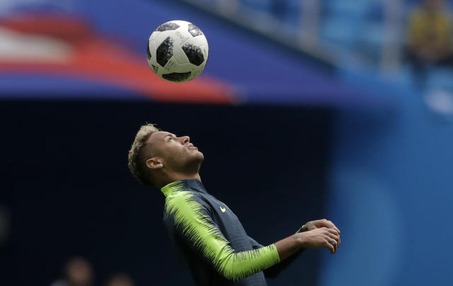 Brazil's Neymar warms up before the group E match between Brazil and Costa Rica at the 2018 soccer World Cup in the St. Petersburg Stadium in St. Petersburg, Russia, Friday, June 22, 2018. (AP Photo/Petr David Josek)