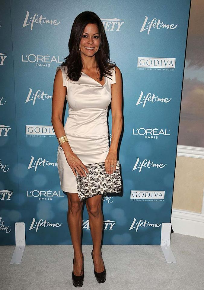 """""""Dancing With the Stars"""" co-host Brooke Burke paired a cream satin mini with black heels and a black-and-white snakeskin clutch. Steve Granitz/<a href=""""http://www.wireimage.com"""" target=""""new"""">WireImage.com</a> - September 30, 2010"""