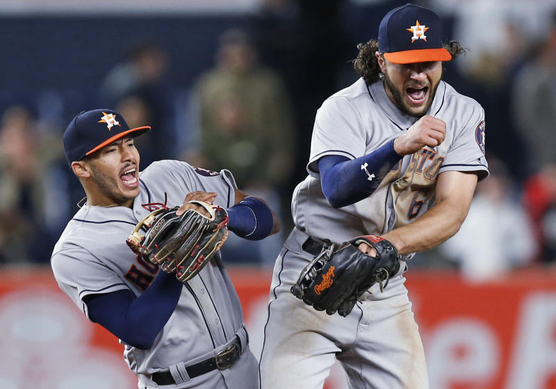 Carlos Correa and Jake Marisnick both came up big in Houston's series-opening victory in New York. (AP Photo/Kathy Willens)