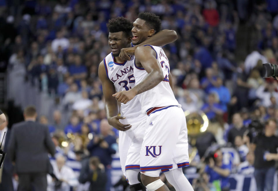 Kansas' Udoka Azubuike, left, and Silvio De Sousa celebrate after defeating Duke 85-81 in overtime of a regional final game in the NCAA men's college basketball tournament Sunday, March 25, 2018, in Omaha, Neb. (AP Photo/Charlie Neibergall)