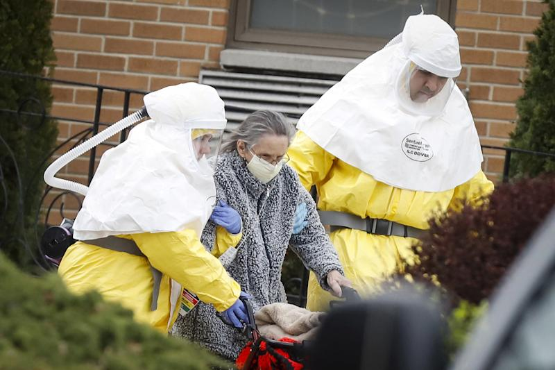 Image: Medical officials at a nursing home (Stefan Jeremiah / Reuters)