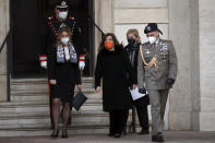 President of the Italian Senate, Elisabetta Alberti Casellati, 3rd from right, arrives at the Qurinale presidential palace for consultations with President Sergio Mattarella, in Rome, Wednesday, Jan. 27, 2021. Italian Premier Giuseppe Conte resigned after a key coalition ally pulled his party's support over Conte's handling of the coronavirus pandemic, setting the stage for consultations this week to determine if he can form a third government.(AP Photo/Alessandra Tarantino)