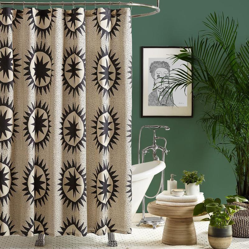 """<p><strong>Jungalow</strong></p><p>jungalow.com</p><p><strong>$62.00</strong></p><p><a href=""""https://www.jungalow.com/collections/bed-bath/products/soleil-shower-curtain"""" rel=""""nofollow noopener"""" target=""""_blank"""" data-ylk=""""slk:Shop Now"""" class=""""link rapid-noclick-resp"""">Shop Now</a></p><p>If you already have a ton of lil plants in your bathroom, you might as well add this sun medallion curtain to emphasize those bohemian vibes.</p>"""