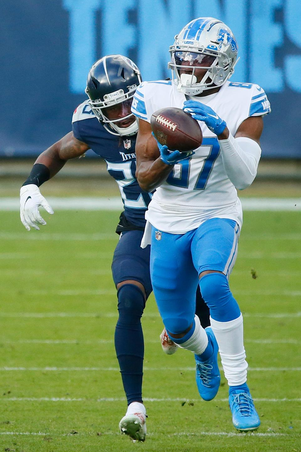 Wide receiver Quintez Cephus (87) of the Detroit Lions completes a reception over cornerback Tye Smith (23) of the Tennessee Titans in the fourth quarter of the game at Nissan Stadium on Dec. 20, 2020 in Nashville, Tennessee.