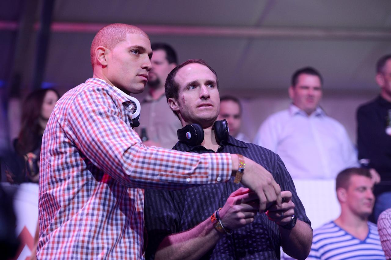 NEW ORLEANS, LA - JANUARY 31:  NFL players Jimmy Graham (L) and Drew Brees (R) of the New Orleans Saints attend EA SPORTS Madden Bowl XIX at the Bud Light Hotel on January 31, 2013 in New Orleans, Louisiana.  (Photo by Stephen Lovekin/Getty Images for Bud Light)