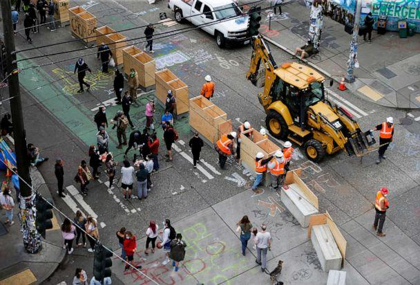 PHOTO: Seattle Department of Transportation crews install concrete barriers as protesters against racial inequality occupy space at the CHOP area near the Seattle Police Department's East Precinct in Seattle, June 16, 2020. (Lindsey Wasson/Reuters)