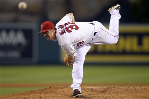 Los Angeles Angels starting pitcher C.J. Wilson throws to the plate during the second inning of their baseball game against the Texas Rangers, Wednesday, Sept. 19, 2012, in Anaheim, Calif. (AP Photo/Mark J. Terrill)