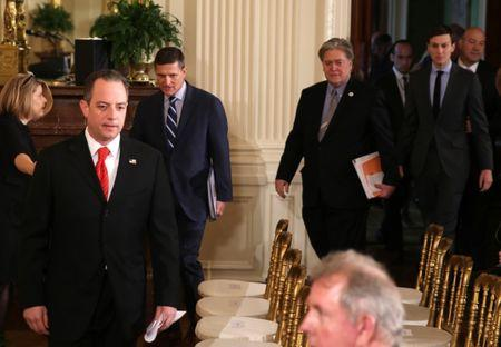 U.S. President Donald Trump's top White House staff, including (L-R) Chief of Staff Reince Priebus, National Security Advisor Michael Flynn, Chief Strategist Steve Bannon and Senior Advisors Stephen Miller and Jared Kushner, enter the East Room to attend a joint news conference being held by President Trump and British Prime Minister Theresa May at the White House in Washington, U.S., January 27, 2017.   REUTERS/Carlos Barria - RTSXP8J