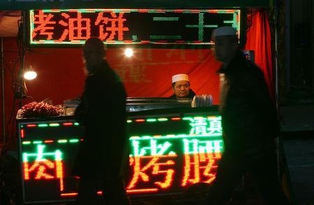 A man sells food at a night market in China's Linxia, Gansu province, home to a large population of ethnic minority Hui Muslims, February 1, 2018. Picture taken February 1, 2018. REUTERS/Michael Martina