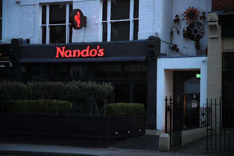 LONDON, ENGLAND - MARCH 22: The closed East Putney Nando's restaurant is pictured on March 24, 2020 in London, England. Coronavirus (COVID-19) has spread to at least 195 countries, claiming over 16,500 lives and infecting over 380,000 people. There have now been 6,650 diagnosed cases in the UK and 335 deaths. (Photo by Andrew Redington/Getty Images)