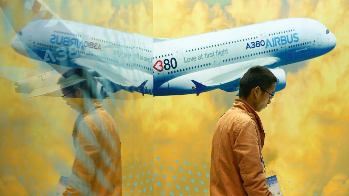 """<div class=""""inline-image__caption""""> <p>A man walks past an Airbus A380 poster at the Beijing International Aviation Expo in Beijing on Sept. 17, 2015.</p> </div> <div class=""""inline-image__credit""""> Wang Zhao/Getty </div>"""