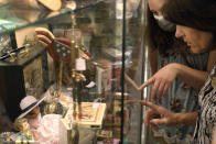 Patti Nemeck, right, and Lena Anderson from Macon, Ill., point out items of interest at the Galesburg Antiques Mall, Wednesday, June 16, 2021, in Galesburg, Ill. (AP Photo/Shafkat Anowar)