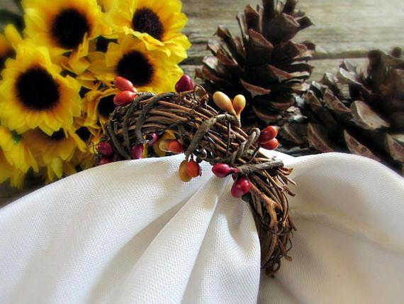 "These <a href=""https://www.etsy.com/listing/168382193/thanksgiving-napkin-rings-pip-berry?ga_order=most_relevant&ga_search_type=all&ga_view_type=gallery&ga_search_query=grapevine%20napkin%20rings&ref=sr_gallery_4"" target=""_blank"">rustic napkin rings</a> will add the perfect touch of fall decor to any Thanksgiving table setting."