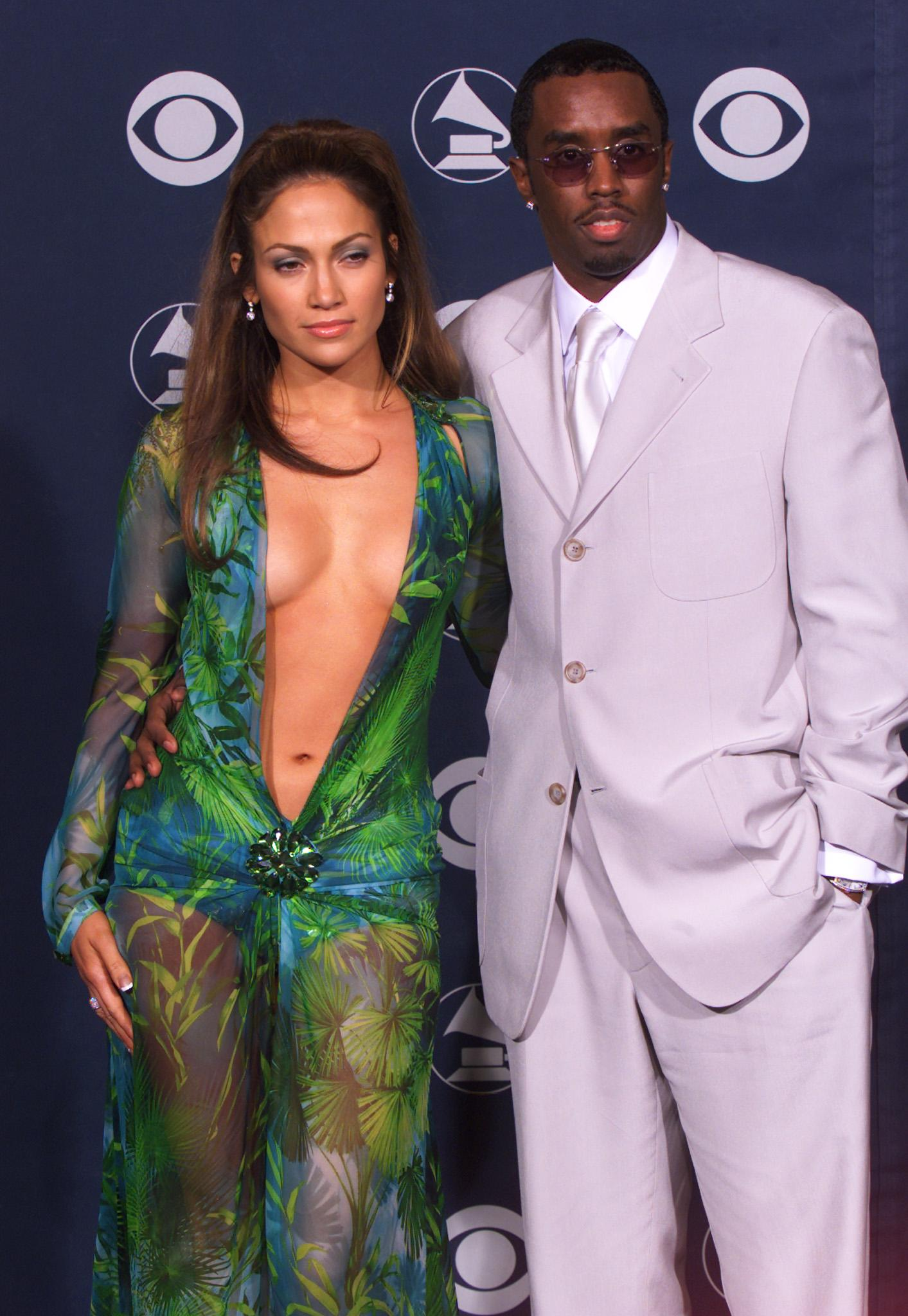 """Jennifer Lopez was dating Sean """"Diddy"""" Combs in 2000, the year she made a splash at the Grammys in a green Versace dress. (Photo: Reuters)"""