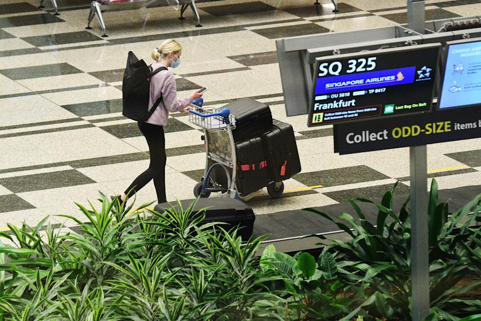 A traveller in the baggage hall at Singapore's Changi Airport.