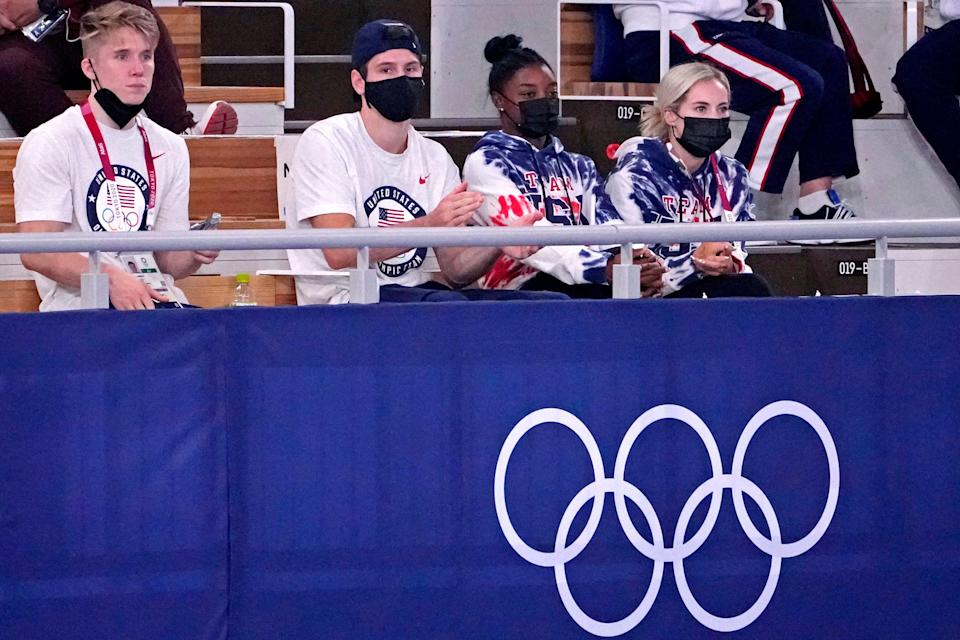 Simone Biles watches the men's individual all-around final.
