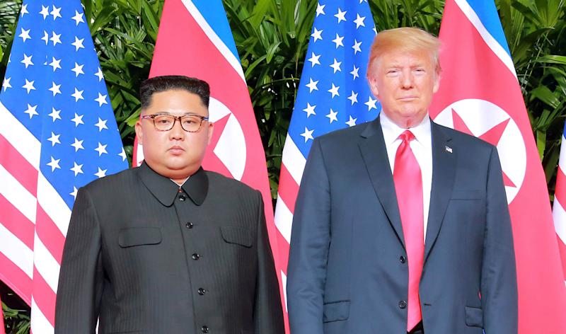 North Korean leader Kim Jong Un poses with U.S. President Donald Trump in Singapore on June 12, 2018.