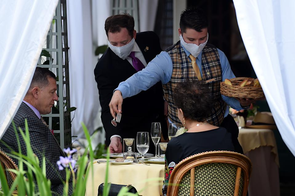 Customers dine outside at The Inn at Little Washington, one of the countrys most renowned restaurants, on the first day of Virginia's phase one reopening in Washington, Virginia on May 29, 2020. - Today marks the beginning of phase one in the state with restaurants reopening following the stay at home orders from the COVID-19 pandemic, provided they can serve customers outdoors with groups sitting at least 6 feet apart. (Photo by Olivier DOULIERY / AFP) (Photo by OLIVIER DOULIERY/AFP via Getty Images)