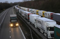 Trucks are parked up on the M20, as more arrive to join the queue, part of Operation Stack in Ashford, Kent, England, Friday, Dec. 25, 2020. Thousands wait to resume their journey across The Channel after the borders with France reopened. Trucks inched slowly past checkpoints in Dover and headed across the Channel to Calais on Thursday after France partially reopened its borders following a scare over a rapidly spreading new virus variant. (AP Photo/Kirsty Wigglesworth)