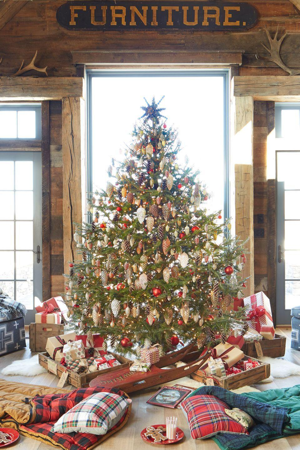 <p>Natural pinecones, gold pinecones, glitter pinecones: This fir has them all. (And we bet a few scented ones too, for good measure.) </p>